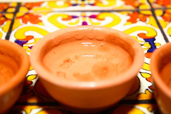 A clay sipping cup filled with mezcal from Del Maguey, the Distiller of the Year. | Photo: Lush Life Productions