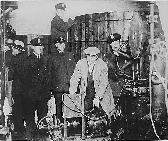 Detroit police inspect equipment in a clandestine underground brewery.