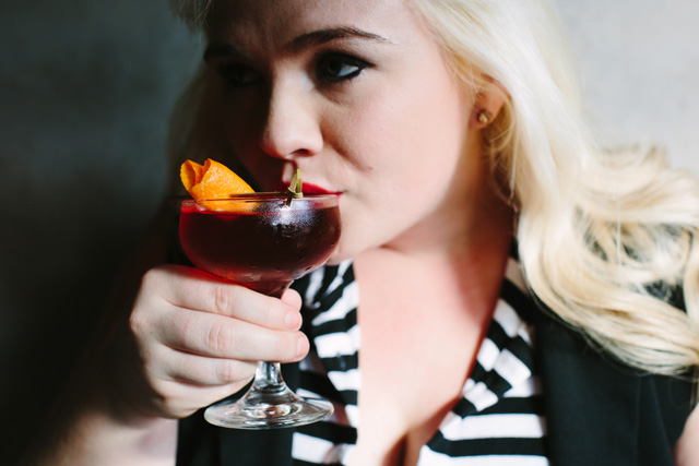 Brynn Smith sips her That's Amore cocktail at Sotto