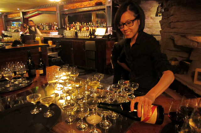 Cari Hah pours champagne at Clifton's Cafeteria