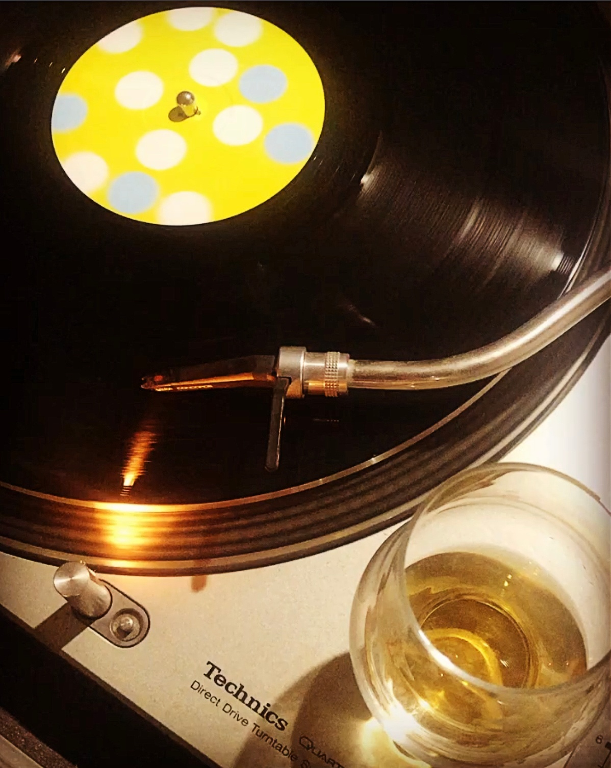 "A dram of Nikka Taketsuru 12-Year and Kaito ""Beautiful Day"" on vinyl"